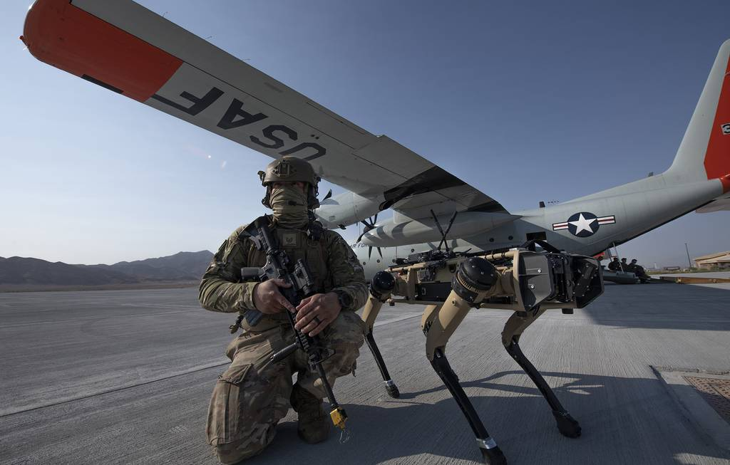 Tech. Sgt. John Rodiguez provides security with a Ghost Robotics Vision 60 prototype at a simulated austere base during the Advanced Battle Management System exercise on Nellis Air Force Base, Nev., Sept. 1, 2020.