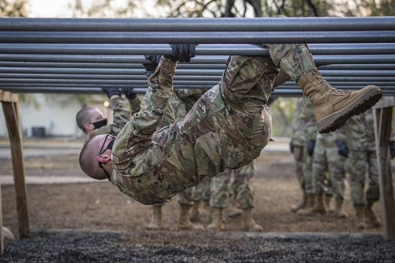 A U.S. Space Force trainee participates on the over-and-under bars obstacle during Basic Expeditionary Airman Skills Training at Joint Base San Antonio-Chapman Annex, Texas, Dec. 2, 2020.