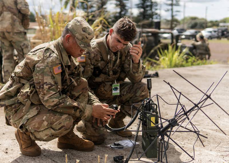 Army soldiers assigned to the 25th Infantry Division, Schofield Barracks, Hawaii, participate in a test of the Navy's Mobile User Objective System (MUOS), a next-generation narrowband satellite communications capability, on May 8, 2019. (Steven Davis/U.S. Navy)