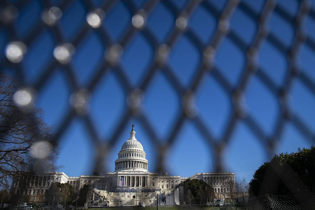 The U.S. Capitol is seen behind security fencing on Jan. 9, 2021, in Washington.