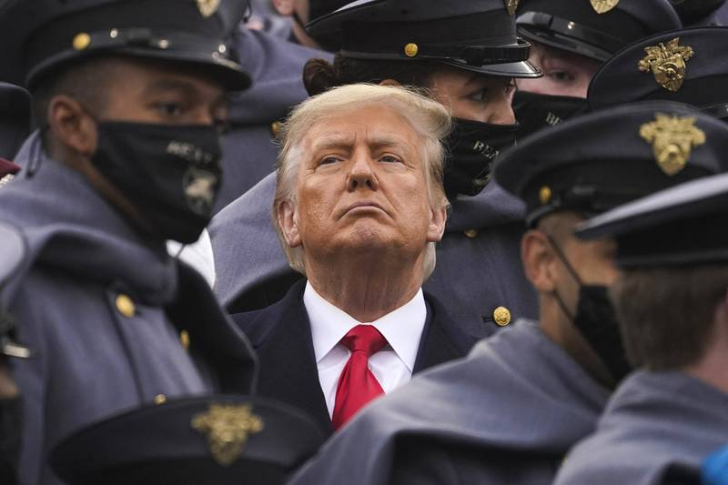 Surrounded by Army cadets, President Donald Trump watches the first half of the 121st Army-Navy Football Game in Michie Stadium at the United States Military Academy, Saturday, Dec. 12, 2020, in West Point, N.Y.