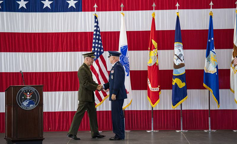 Joint Chiefs of Staff Gen. Joseph F. Dunford Jr., left, shakes hands with Gen. John W. Raymond, the commander of the U.S. Space Command